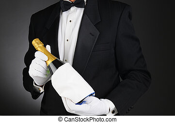 Sommelier with Champagne Bottle - Closeup of a Sommelier...