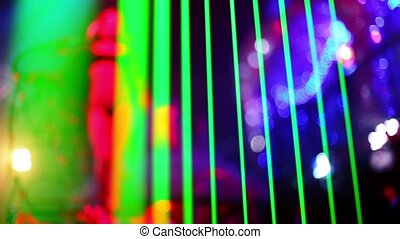 Almost nude young female dance in night club, unfocused view