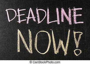 Deadline Now written on a blackboard