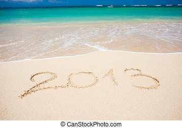 New year background of beach with quot;2013quot; handwritten...