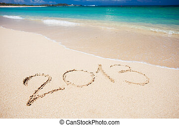 """New year background of beach with """"2013"""" handwritten in the..."""