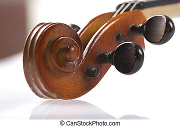 Violin Scroll - A violin scroll bath in light with white...