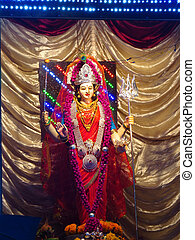 Goddess Durga - An idol of Goddess Durga decorated on the...