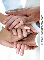 Friendship - Vertical image of pile of hands of business...