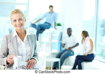 Cheerful blonde - Portrait of happy female with cup and...