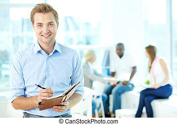 Man with notepad - Portrait of happy man with pen and...