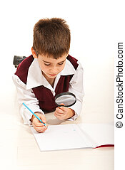 Schoolboy with magnifier home - Schoolboy using magnifier...