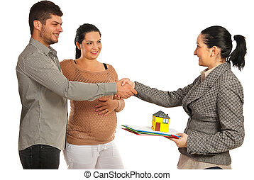 Pregnant couple buying new house - Pregnant woman and her...