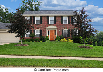 Brick Suburban Home on a sunny summer day