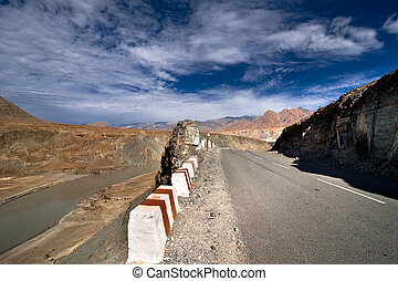 Road going across Himalaya mountains along Indus river under...