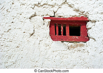 Red window frame - Old red window frame on white wall at...