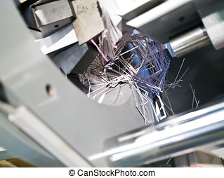 part of printing machine with broken papers