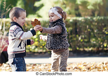 Kids playing in autumn park