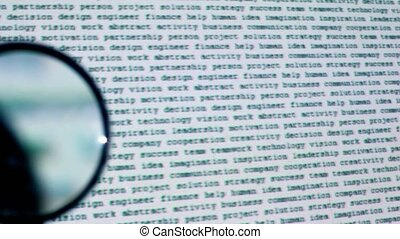 Round magnifying glass moves over text projection on wall...