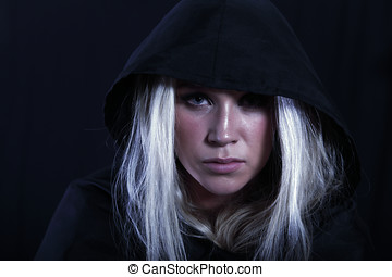 Conspirateur, a woman in black cloak