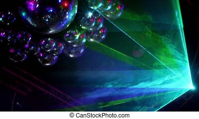 Multiple rays laser beams in smoke and many discoballs in...