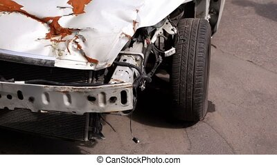 Crashed car after accident stand at road side, closeup view...