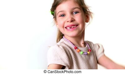 Little girl with slingshot isolated on white background