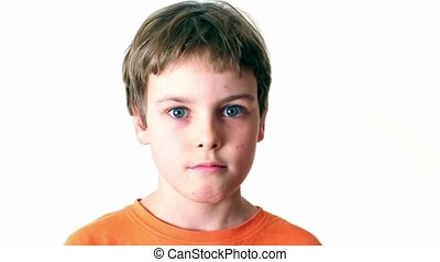 Little boy looks and turn around isolated on white...