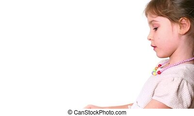 Little girl with slingshot sideview isolated on white...