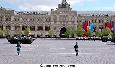 Carriers with soldiers on it ride by Red square on Victory...