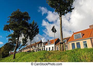 Dutch dike houses - Row dutch dike houses in village...