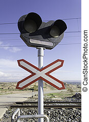 Traffic signal in route of train with semaphores, road...