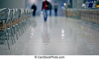 Man people walk in cafe, unfocused view - Man people walk in...