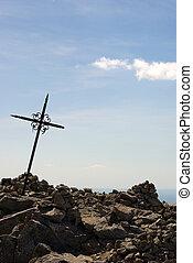cross shape - A cross on a mountain peak