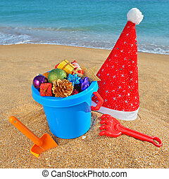 Christmas toys and decorations on the beach - Christmas...