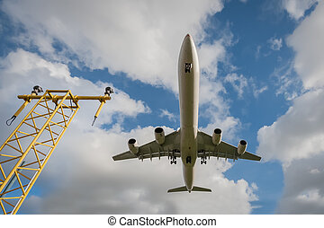 passenger jet landing - wide-angle view of a passenger jet...