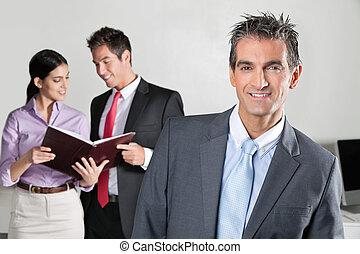 Confident Businessman Smiling - Portrait of confident...