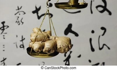 ginger root on a balance