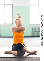 Mature woman exercising yoga