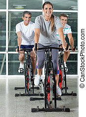 Friends On Exercise Bikes