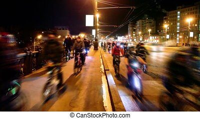 Many bicyclists ride over bridge with traffic in Moscow at...
