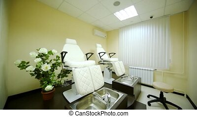In cosmetology room for pedicure in beauty salon there are two special seats