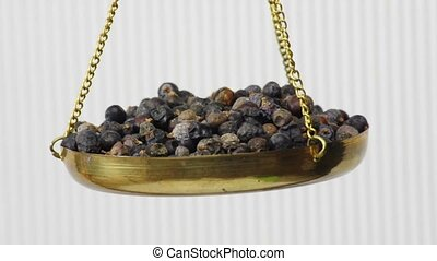 juniper berries on a balance