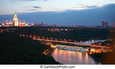 Luzhnetsky bridge stands against the Moscow State university...