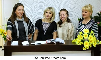 Four employees of beauty salon kindly look and smile
