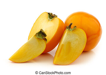 fresh kaki fruit and some cut pieces on a white background