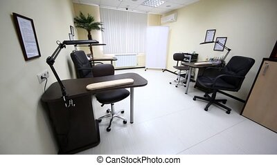 In beauty salon stands modern furniture of black-and-white color