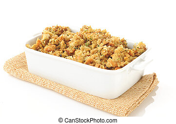Turkey stuffing - A casserole dish of herb stuffing in...