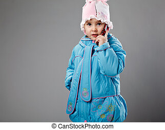 funny little girl on gray with phone