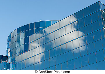 Modern Office Building Reflecting the Clouds - A modern...