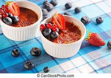 Creme brulee (cream brulee, burnt cream) with fruits and...