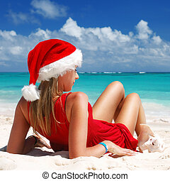 Caribbean Christmas - Woman on the beach in santa's hat