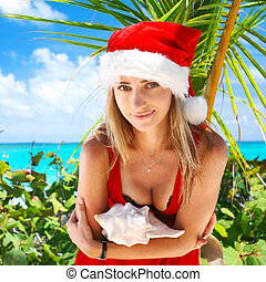 Caribbean christmas - Woman on the beach in santas hat