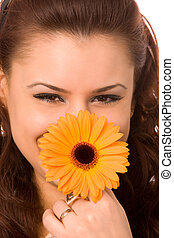 woman with flower - close-up portrait of young woman with...