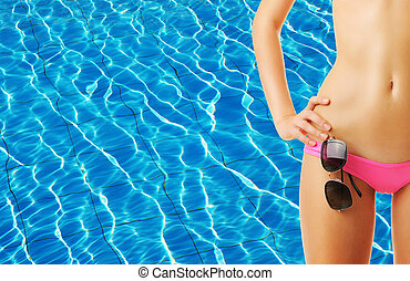 Girl at pool - Girl with sunglasses at tropical swimming...